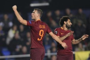 Roma's Edin Dzeko, left, celebrates scoring his side's 2nd goal during a Europa League, Round of 32, 1st leg soccer match between Villarreal and Roma at the Ceramica stadium in Villarreal, Spain, Thursday Feb. 16, 2017. (ANSA/AP Photo/Alberto Saiz) [CopyrightNotice: Copyright 2017 The Associated Press. All rights reserved.]