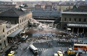 "General view of Bologna Central station and of wagons of the Ancona-Chiasso train pictured on August 02, 1980 in Bologna after a terrorist bombing which killed 85 people and wounded more than 200. At 10:25 am., August 02, a timed improvised explosive device (IED) contained in an unattended suitcase detonated inside an air-conditioned waiting room, which, the month being August (and with air conditioning being uncommon in Italy at the time), was crammed full of people. The IED was made of TNT, T4 and a ""Compound B"", also known as Composition B. The explosion destroyed most of the main building and hit the Ancona–Chiasso train that was waiting at the first platform. The attack has been attributed to the neo-fascist terrorist organization, Nuclei Armati Rivoluzionari.   AFP PHOTO (Photo credit should read -/AFP/Getty Images)"
